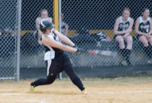 TIFFANY CARTER shows her swing earlier this season.  Carter belted a three-run homer yesterday to help lift the Lady Tide to a 5-0 win over Ridgway