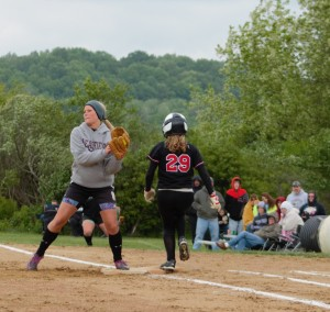 Curwensville second-baseman Taylor Goodman covers first on a bunt attempt by Moniteau's Emily Hiwiller.  The Lady Tide  advanced to the District IX Championship game with a 12-0 win.