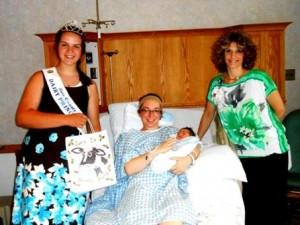 Tiffany presents her gift bag to Alex and Easton with nurse manager, Julie Vitko, R.N. (Provided photo)