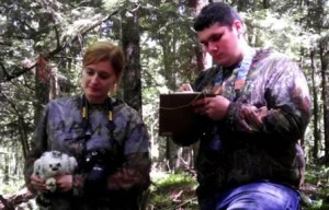 April Sperfslage and Toby Neal, graduates of the Penn State DuBois Wildlife Technology Program, gathers data on a goshawk chick before releasing it back into the wild. (Provided photo)