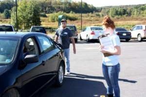 Student Shane Thomas checks a driver's visibility in their rear view mirrors while classmate Ashley Barr looks for ways to adjust the mirrors for improved visibility. The goal is for the driver to be able to see how many fingers Shane is holding outward. (Provided photo)