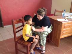 Dr. Brittany Barker examines Gary, a child at an orphanage run by Love in Action International Ministries. (Provided photo)