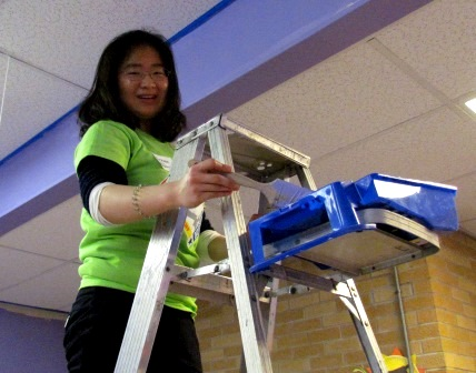 Penn State DuBois Freshman Sichen Li applies fresh paint to the interior of the Children's Center of Mercer County during the MLK Day of Service.  (Provided photo)