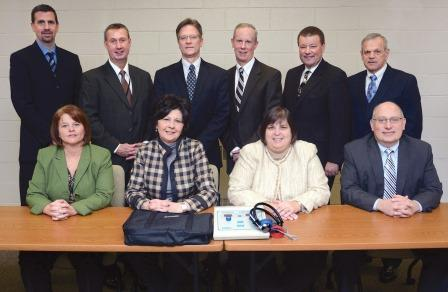 At the presentation were (from left): seated - Cathy Harlow of Tyrone Area, Linda K. Smith of Williamsburg Community, Royce Boyd of Claysburg-Kimmel and G. Brian Toth, DEd, of Bellwood-Antis; standing - Robert Gildea, DEd, of Hollidaysburg Area, Thomas Otto, DEd, of Altoona Area; Jerry Murray, president, UPMC Altoona; Bruce Erb, senior vice president, First National Bank & Trust Group; Tim Balconi, foundation president, and Robert Vadella, PhD, of Spring Cove. (Provided photo)