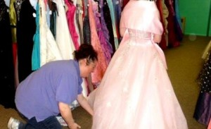 Pictured is Melissa Henry, Prom Closet coordinator, assisting a student with trying on a prom gown. (Provided photo)