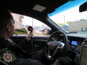 A Pennsylvania State Police trooper uses radar to determine the speed of vehicles traveling on Route 153 (Second Street) in Clearfield. The operation was a joint effort between the state police and Clearfield Borough police. (Provided photo)
