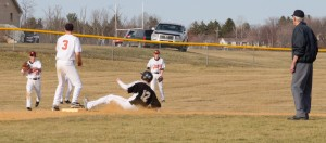 DRAWING A CROWD -Curwensville Senior Tanner Elensky slides safely into second base after a pop-up single by  Travis Lansberry as several Clarion players converge on the play.  Clarion bested Curwensville 10-0 in favie innings yesterday afternoon.  (photo by Rusty McCracken)