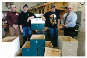 Pictured are Dave Rishell, Jeff Tech Building Trades instructor; Ben Whaley and Collin Whitehouse, Jeff Tech Building Trades students; and Bob Michael, beekeeper. (Provided photo)