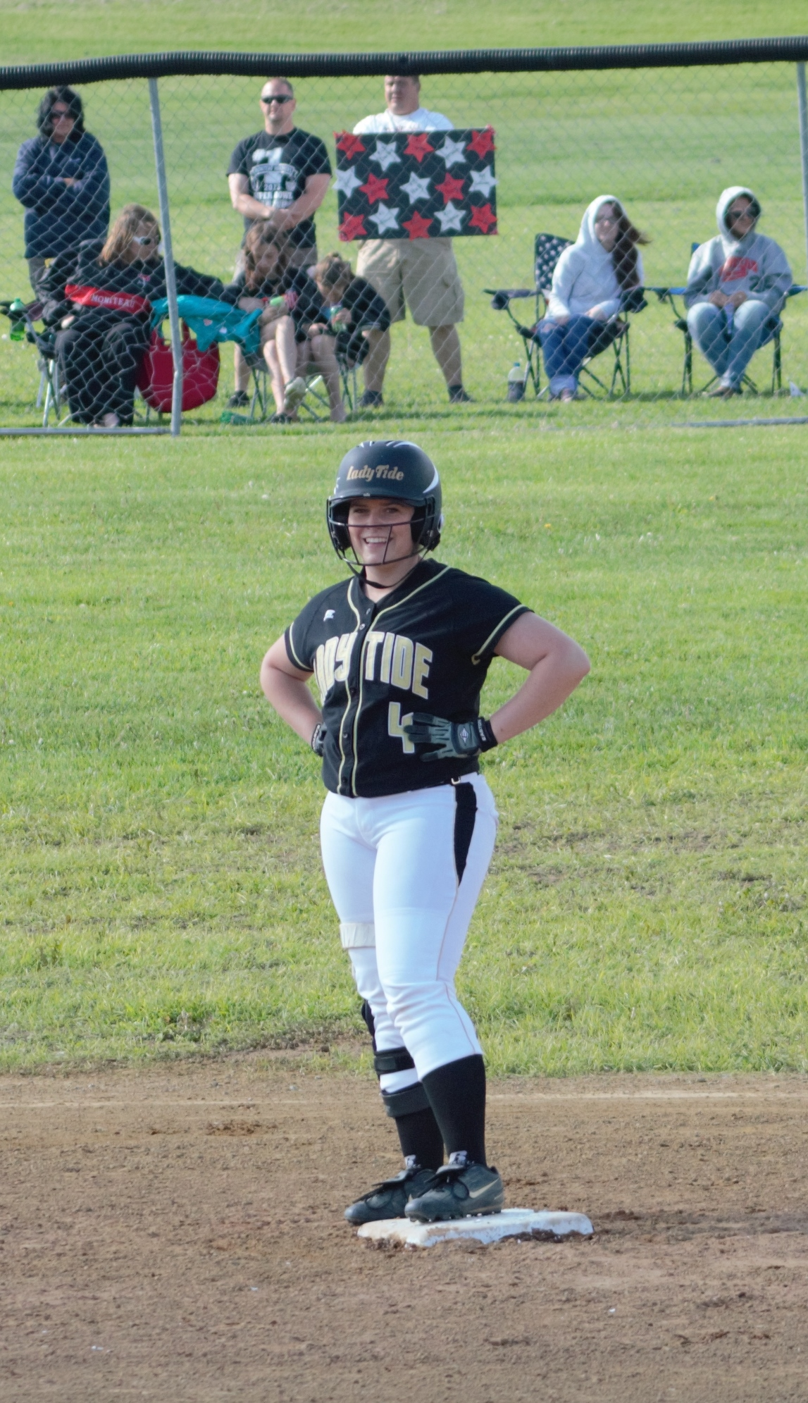 Lady Tide senior Bethany Carns shows a smile to her teammates after breaking up a Moniteau no-hitter in the District IX Class AA semifinal game on Thursday.  Curwensville's season came to an end with a 4-0 loss to the Warriors.  (photo by Rusty McCracken)