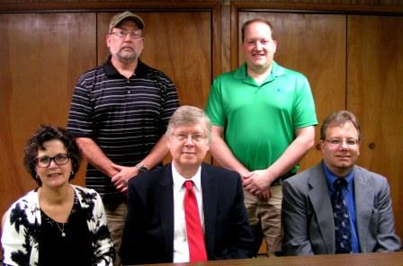Pictured, from left in front, are Clearfield County Commissioners Joan Robinson-McMillen, John A. Sobel and Mark B. McCracken. In the back are Fair Manager Greg Hallstrom and Fair President David Franson II. (Provided photo)