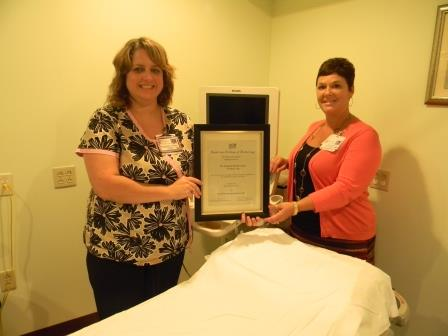 Lisa Redmond, lead ultrasound sonographer (left), and Women's Center manager, Lisa Housler, display an award received for excellence in ultrasound-guided breast biopsies.  (Provided photo)