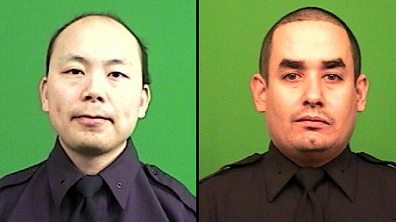 After 2 NYPD officers killed, more threats against police arise