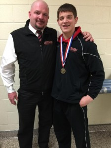 Clearfield Bison head coach with state qualifer Luke McGonigal (Photo by Greg Billotte)