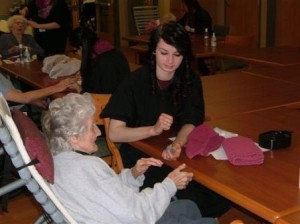 Pictured is Rachel Fisher from the Jeff Tech Cosmetology program with a resident of Christ the King Manor. (Provided photo)