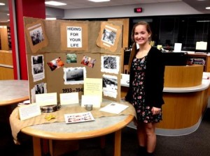 Ninth grade English student, Erica Hanes, is pictured with her Holocaust research display at the library at the Clearfield Area Junior-Senior High School. (Photo by Jessica Shirey)