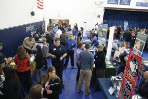 Job seekers learn about career opportunities from local industry representatives at the Penn State DuBois Career Fair in the campus gymnasium. (Provided photo)