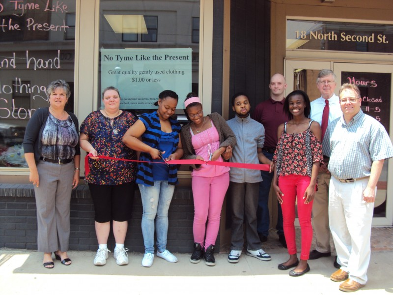 (Provided Photo)Left to right is: Main Street Manager, Loretta Wagner (CRC), Cindy Poole, Owner Elaine Newkirk, Shante Newkirk, Jaire Newkirk, , Dominique Newkirk, and Commissioner Mark McCracken.  Second Row: Shawn McCully, and Commissioner John Sobel.