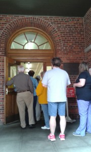 "Concerned residents work their way into the Clearfield County Courthouse for a town hall meeting. The meeting was called by the Clearfield Hospital Auxiliary to allow the residents a forum in which to ask questions, make suggestions and to show the ""domino effect"" of how recent decisions about the hospital have impacted the community. (Photo by Kimberly Finnigan)"