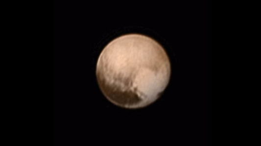 NASA probe nears Pluto, carrying ashes of man who discovered it