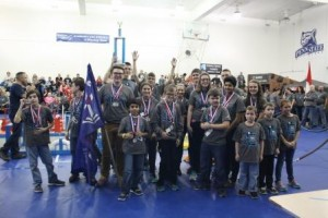 Members of the DuBois Central Catholic Team hoist their trophy in celebration of taking first place in the BEST Robotics Competition at Penn State DuBois on Saturday.  (Provided photo)