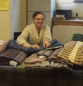 One of the vendors, Robin Greendoner, is pictured showing her homemade rugs. (Provided photo)