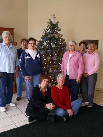 Woman's Club Decorates Trees at Shaw Library