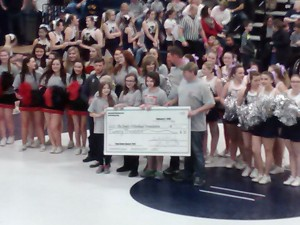 The check presentation at intermission of the Takedown Cancer Match (Photo by Jay Siegel)