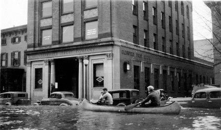 Canoes became a popular way to navigate the streets of Clearfield in March of 1936. Volunteers used boats to rescue many of the people trapped in the downtown area. (© 2003 Clearfield County by Julie Rae Rickard)
