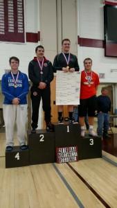 Travis Ogden on the medal stand at 195 (Photo by Lisa Ogden)