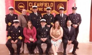 Pictured, from left, are Eric Smith, vice president; Joan Williams; Steve Livergood, president; Michele Capitos, secretary; and Rep. Tommy Sankey.  In back are Mike Mayersky, truck lieutenant; Dave Hallstrom, treasurer; Steve Flanagan, assistant chief; John C. Williams, deputy chief; George Proud, chief and Andrew Smith, engine lieutenant. (Photo by Wendy Brion)