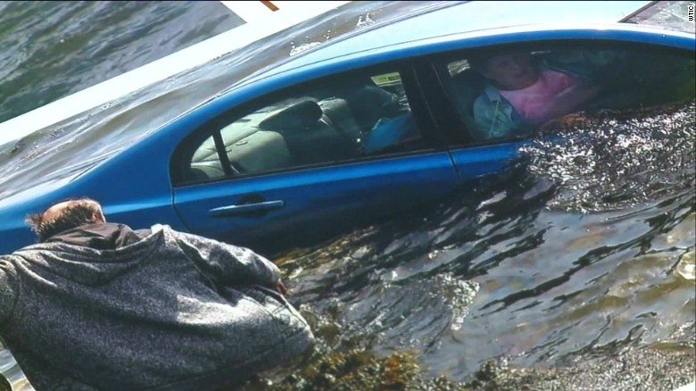 Woman trapped after car goes into water