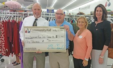 CommunityAid Executive Director Glenn Chandler (second from left) is shown with Red Cross staff members Tom Szulanczyk (North Central Pennsylvania Chapter executive director), Jenn Wiggin (major gift officer) and Sims. (Provided photo)