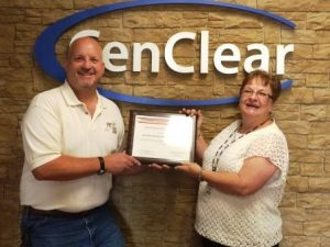 Chris W. Hovanec, senior engineering specialist with FM Global, presents a fire prevention grant award to Judy Patterson, nutrition/safety advisor with Cen-Clear. Funds will be used to support the agency's Project Fire FLIES (Fundamental Lessons in Every Site) safety education program. (Provided photo)