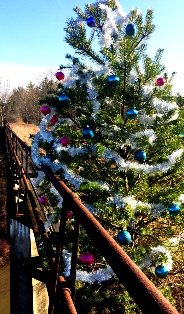 Santa's Elves Redecorate Little Christmas Tree on Railroad Bridge