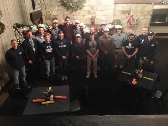 Baseball Team Volunteers with Toys for Tots