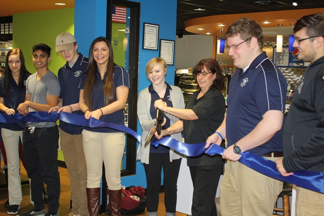 Student Government President Amber Metzger, center left, and Lion's Den Café Manager Shelly Caine cut the ribbon on for the opening of the new Lion's Den Café while joined by other members of the SGA. (Provided photo)
