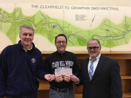 Starr Presents Check to Knights of Columbus Members