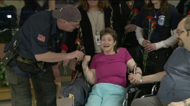 Firefighters Hand Out Carnations at Berwick Retirement Village for Valentine's Day