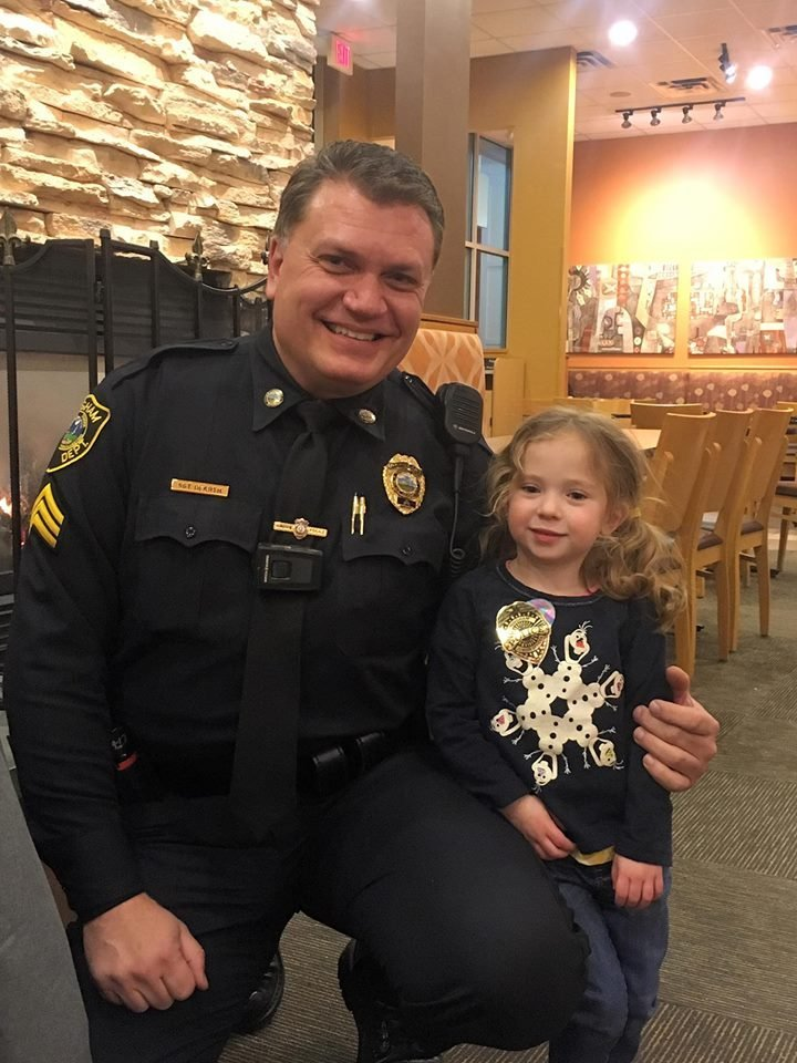 A cop, a little girl and their adorable dinner date