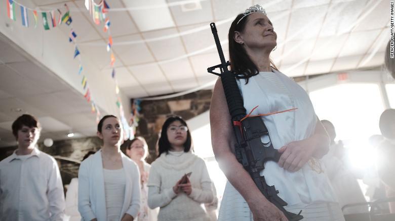 Pennsylvania couples clutching AR-15 rifles renew wedding vows