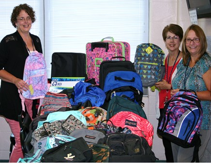 SCI Houtzdale Staff Members Donate to Children's Aid Society