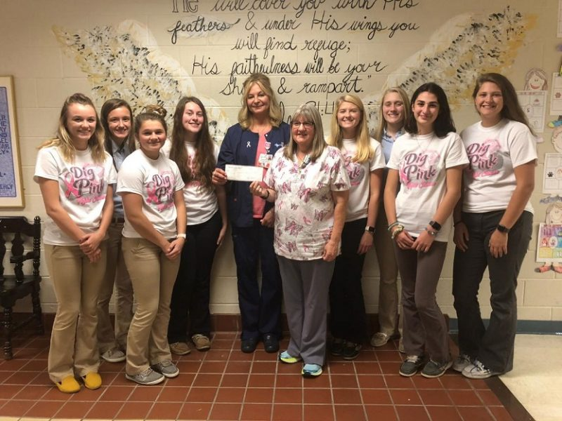 DCC Girls' Volleyball Team Makes Pink Night Donation